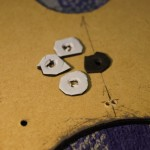 8mm M4 tweeter retaining screw goes through grommet